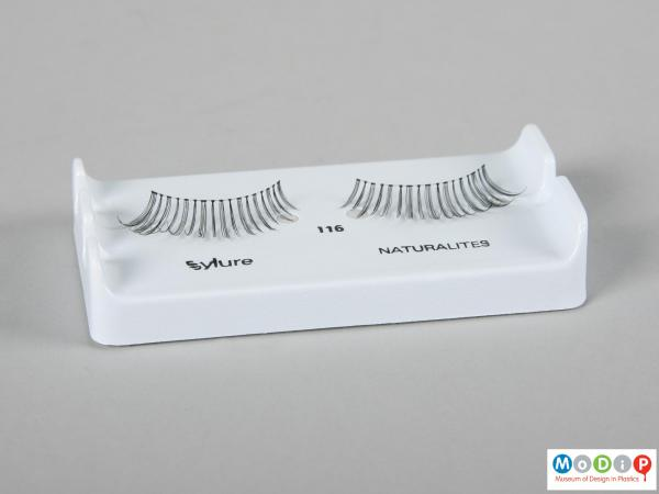 Front view of a pair of false eyelashes showing the naturally curled lashes.