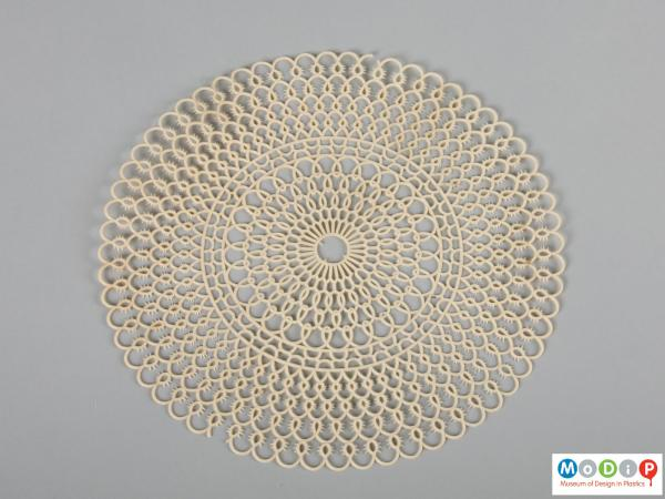 Top view of a table mat showing the intricate pattern.