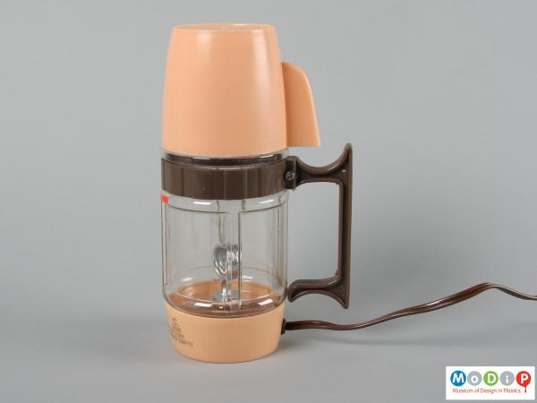 Side view of a coffee maker showing the straight handle.