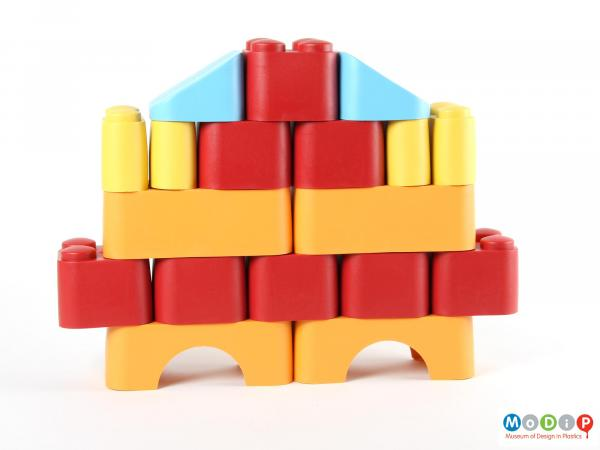 Side view of a set of building blocks showing a built structure.
