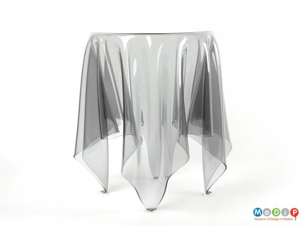 Side view of an Illusion table showing the drape of the material and the legs.