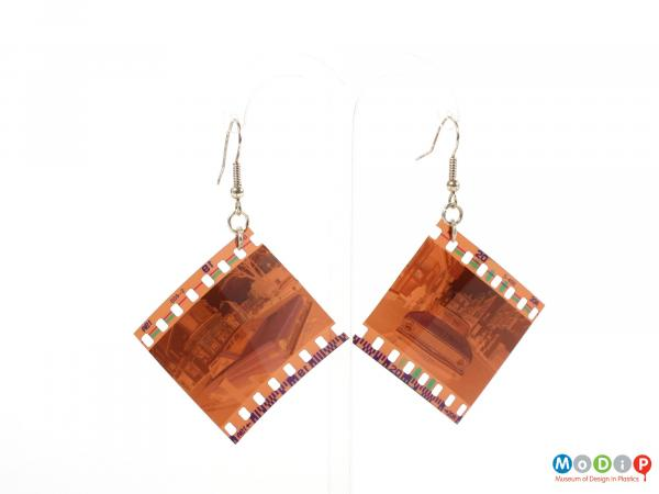 Front view of a pair of Lula dot earrings showing the negatives hanging on the metal fixings.