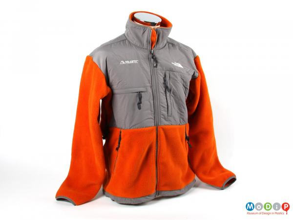 Front view of a jacket showing two types of material used.