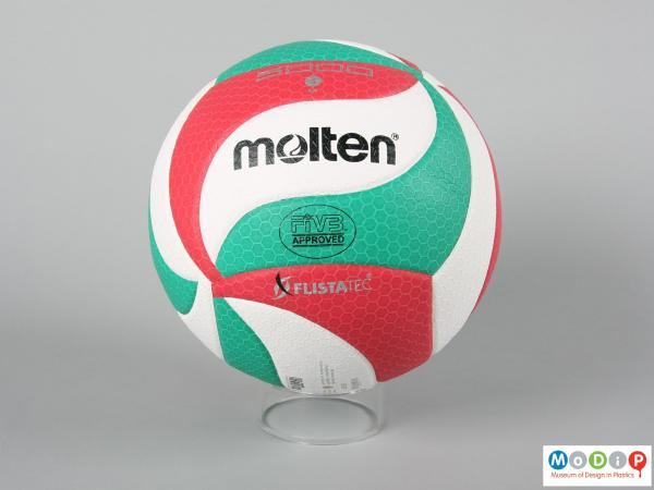 Side view of a volleyball showing sewn sections making up the ball.