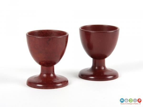 Side view of 2 egg cups showing the goblet shape.