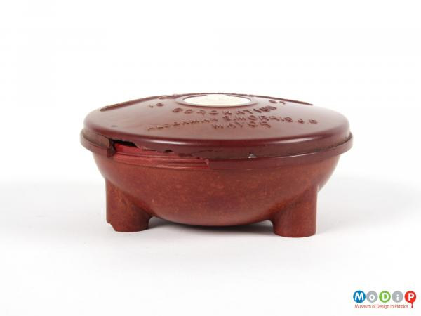 Side view of a trinket box showing the integral legs.
