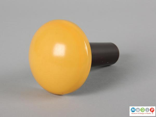 Top view of a darning tool showing the yellow dome.