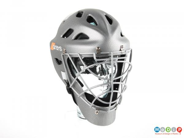 Front view of a hockey helmet showing the face grill.