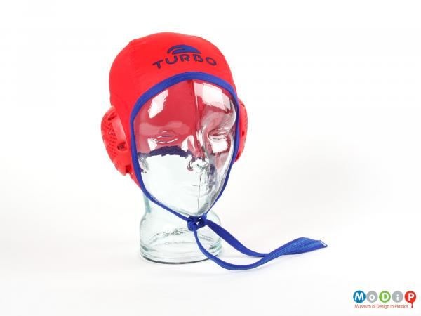 Front view of a water polo cap showing close fitting anture of the cap.