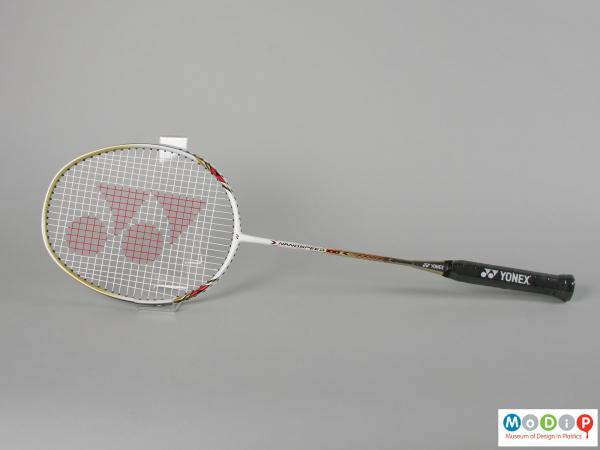 Side view of a badminton racket showing the egg shaped head.