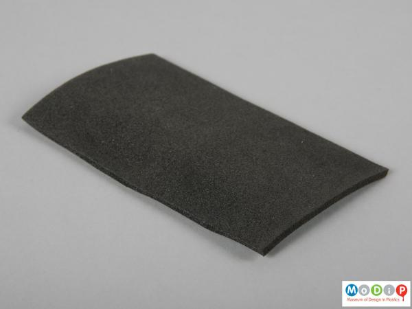 Side view of a foam sample showing the surface texture.