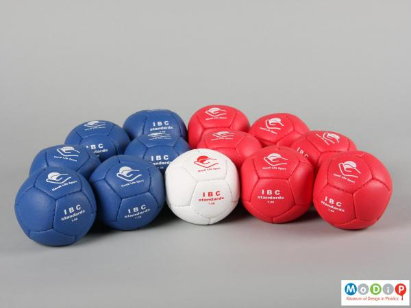 Side view of a set of Boccia balls showing the three colours.