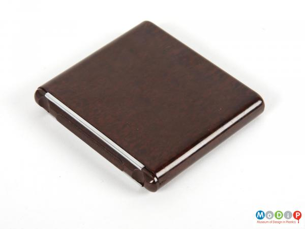 Side view of a cigarette case showing the smooth outer surface.