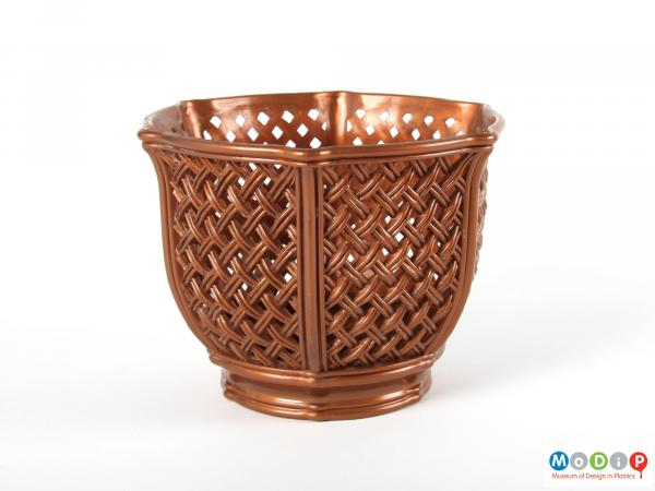 Side view of a plant pot holder showing the basket weave mould patterning.
