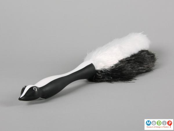 Side view of a brush showing the moulded body shape of the handle.