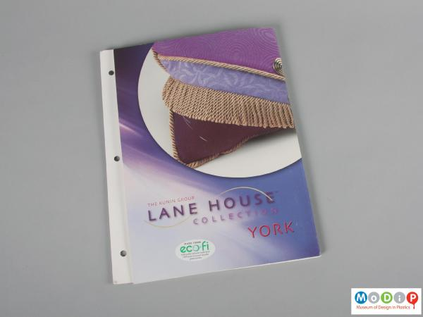 Front view of a sample pack showing a printed folder.