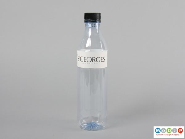 Side view of a bottle showing the straight edges.