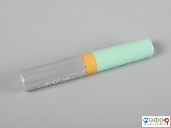 Side view of a tampon case showing the cylindrical shape.