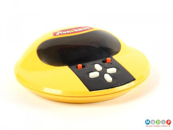 Front view of an electronic game showing the controls.