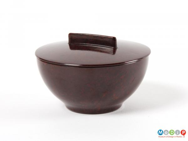 Side view of a lidded pot showing the smooth surface.