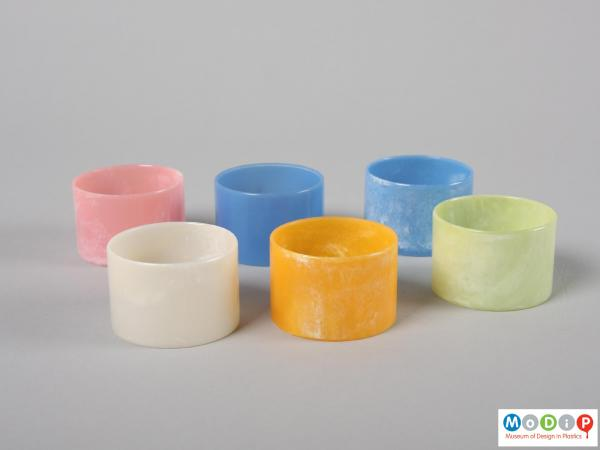 Side view of a set of napkin rings showing the different colours.