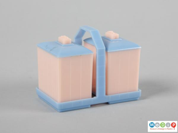 Side view of a cruet set and stand showing the rectangular bodies.