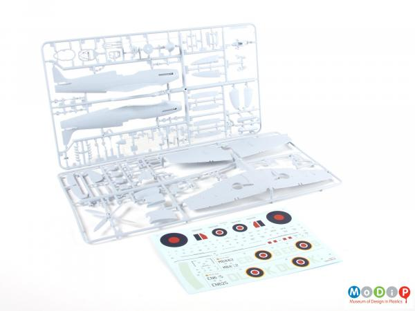 Side view of a model kit showing the panels of injection moulded parts.