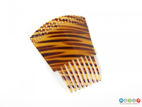Top view of a comb showing the rectangular shape.