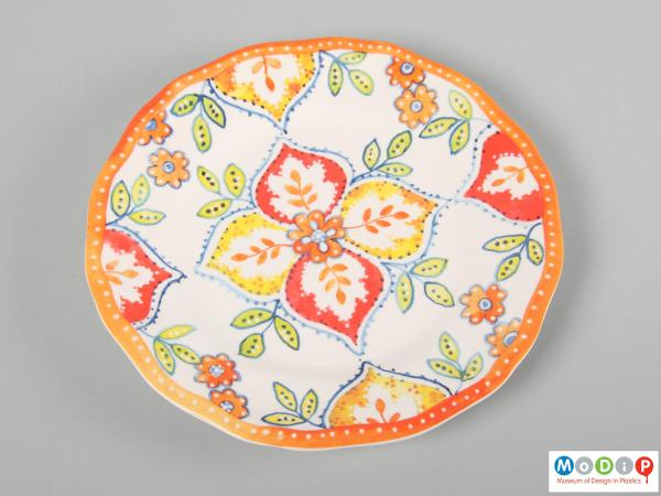 Front view of a plate showing the printed decoration.