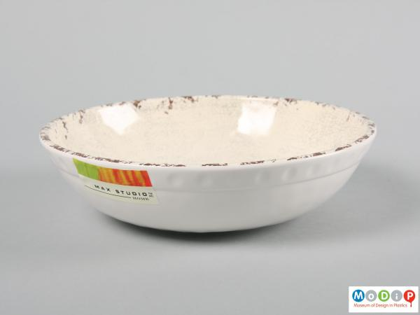 Side view of a bowl showing the uneven surface.