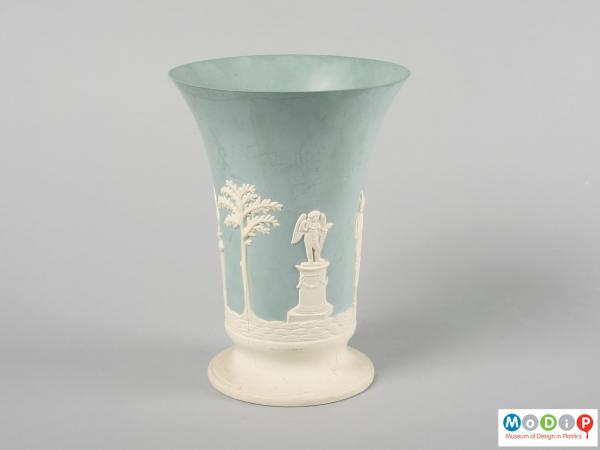 Side view of a vase showing the the cameo style design.