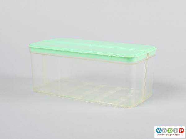 Side view of a food container showing the clear base and green lid.