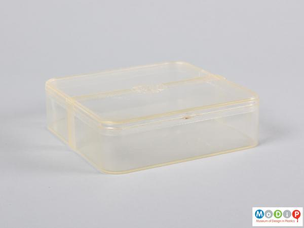 Side view of a food container showing the rounded corners and straight sides.