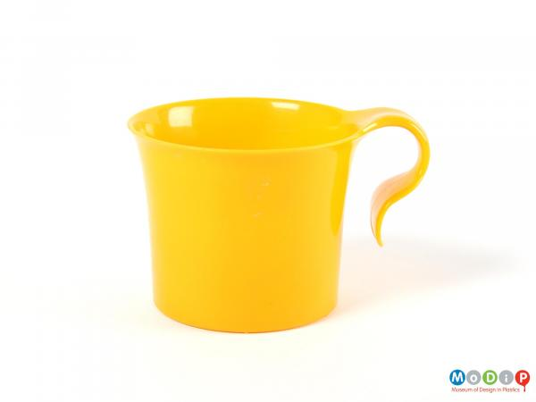 Side view of a cup showing the hook style handle.