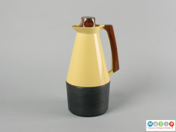 Side view of a coffee pot showing the wooden handle.