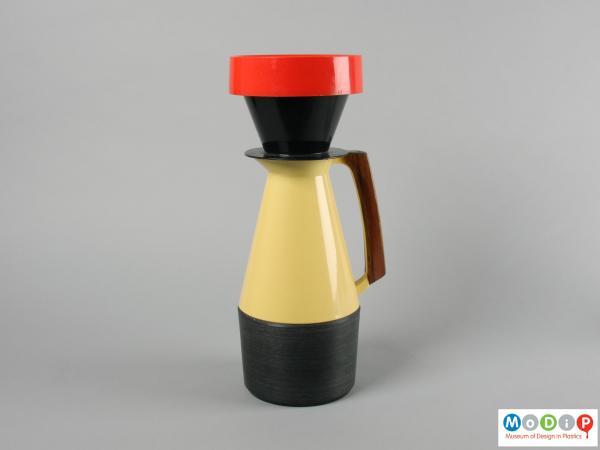 Side view of a coffee pot showing the filter holder.