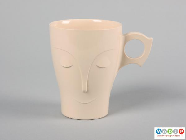 Front view of a mug showing the stylised face.