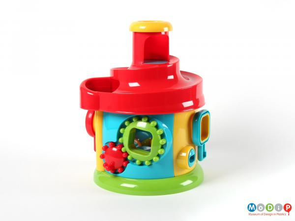 Side view of an activity toy showing the cogs.