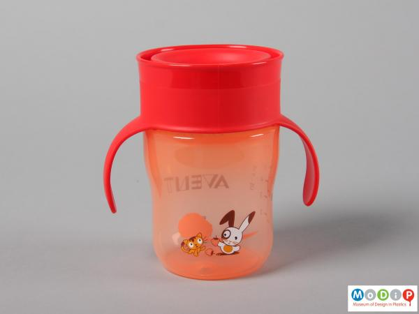 Side view of a cup showing the printed cat and rabbit design.