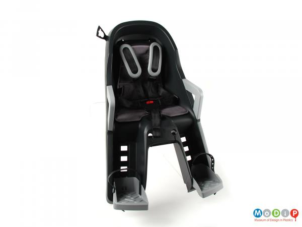 Front view of a child bike seat showing the safety straps.