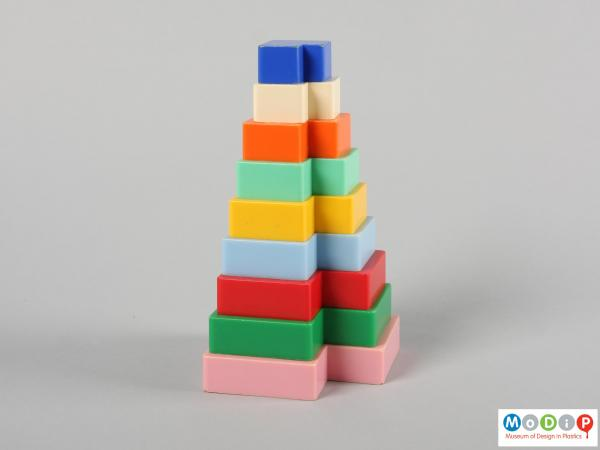 Side view of a set of stacking blocks showing the different colours.