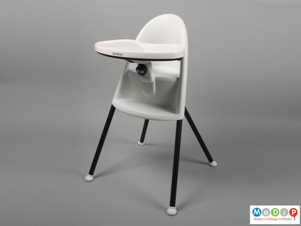 Front view of a highchair showing the table in the widest position.