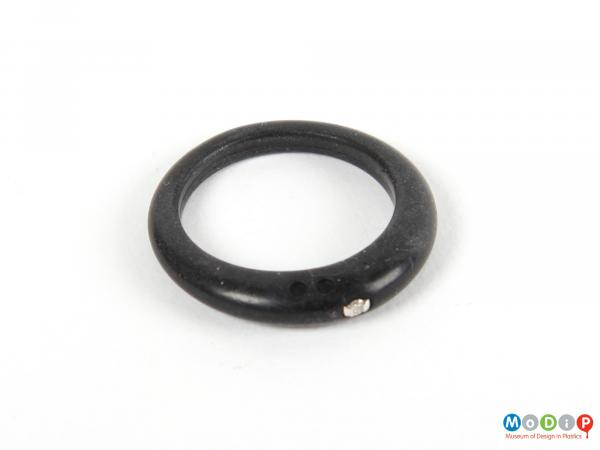 Top view of a ring showing the small diamond.