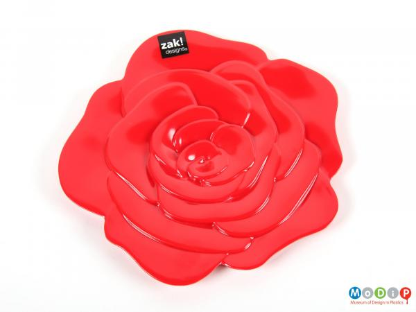 Top view of a trivet showing the moulded petal shapes.