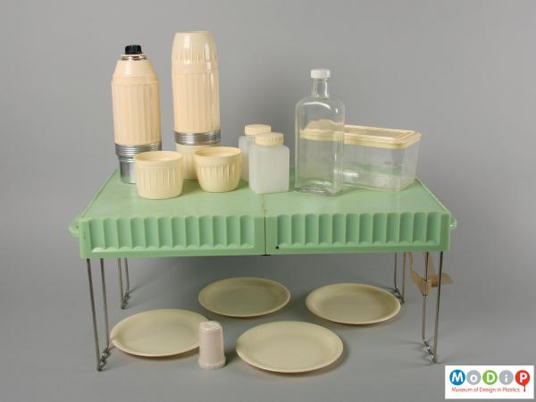 Side view of a picnic set showing the table and the contents.