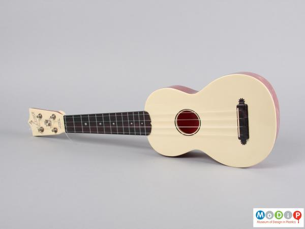 Front view of a ukulele showing the four strings.