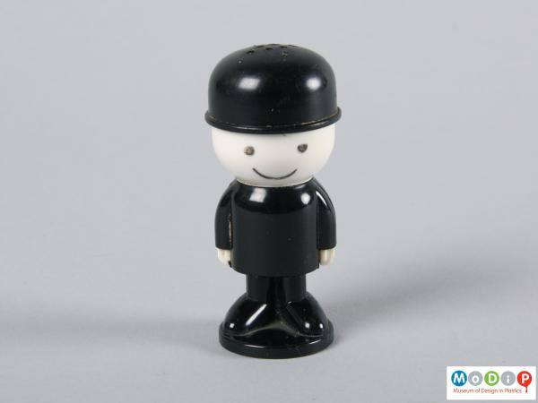 Front view of a pepper shaker showing the suited male figure.