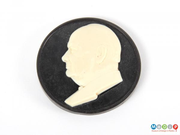 Top view of a cameo showing the white portrait.