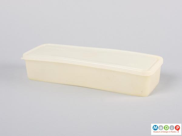 Side view of a food container showing the long shape.