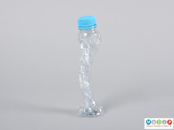 Side view of a bottle showing it twisted.